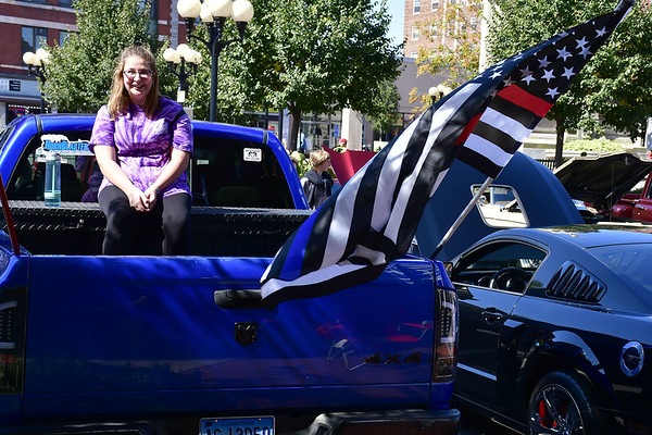 9/21/2019 Mike Orazzi | Staff Emily Madeley sits in the back of a 2007 Dodge Ram 1500 during the New Britain Downtown District's 13th annual car show on Saturday.