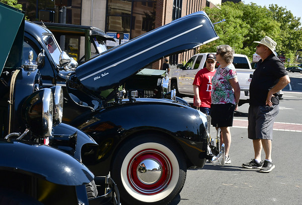 9/21/2019 Mike Orazzi | Staff Members of the Vasil family, Kenny, Rosemary and Bob check out vehicles during the New Britain Downtown District's 13th annual car show on Saturday.
