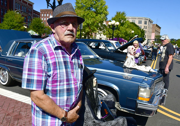 9/21/2019 Mike Orazzi | Staff James Hellandbrand with his 1986 Cadillac Fleetwood Rome during the New Britain Downtown District's 13th annual car show on Saturday.