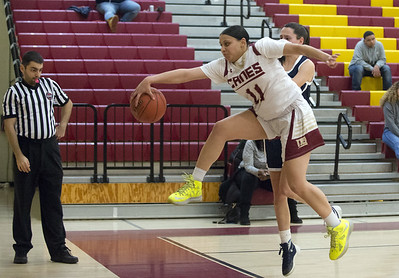 01/24/20   Wesley Bunnell | Staff  New Britain girls basketball defeated Rocky Hill on Friday night in a home game. Nataly Hernandez (11) saves a ball from going out of bounds.