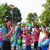 082416  Wesley Bunnell | Staff<br /> <br /> The Amazing Andy performed magic tricks for children present at the annual back to school celebrations at Walnut Hill Park. More than 1000 attendees were on hand for the Wednesday evening event.