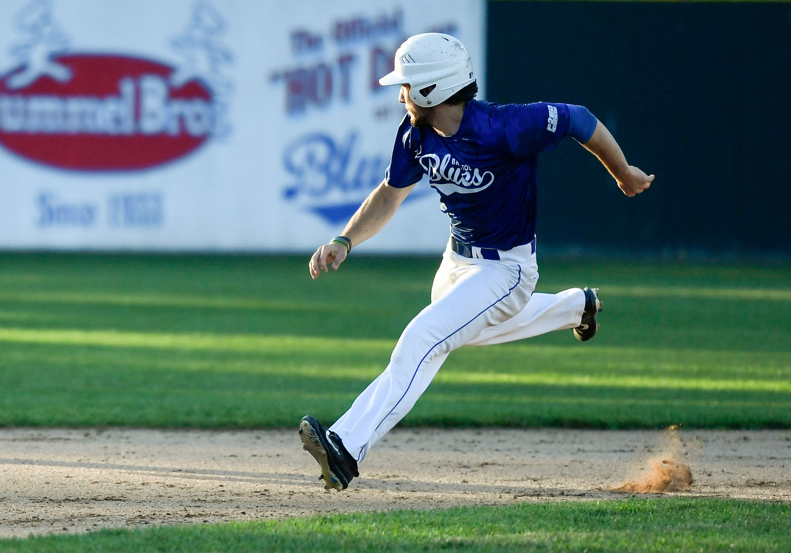 070317  Wesley Bunnell | Staff  The Bristol Blues held military appreciation night at Muzzy Field on Monday evening. Chris Davis (15) eyes the progress of the ball as he rounds second base.