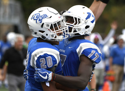 10/7/2017 Mike Orazzi   Staff CCSU's Drew Jean-Guillaume (20) and Courtney Rush (17) during Saturday's football game with the Penn Quakers in New Britain.