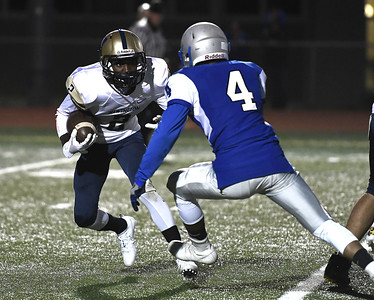 9/28/2017 Mike Orazzi   Staff Newington's Carlum Caldwell (2) and Bristol Eastern's Dayton Forges (4) during Thursday night's football game in Bristol.