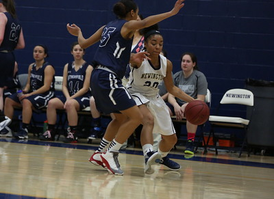 1/22/16 Amelia Parlier | Staff Newington's Gio Rivera and Wethersfield's Cheyenne Smith. Newington played Wethersfield at home on Friday night.