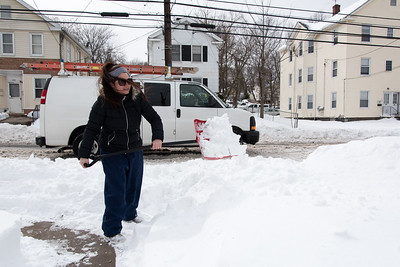 031517  Wesley Bunnell | Staff  Wilmarie DelValle shovels a path near a street crossing on East St. on Wed. March 15 so her children can more easily reach their bus stop.