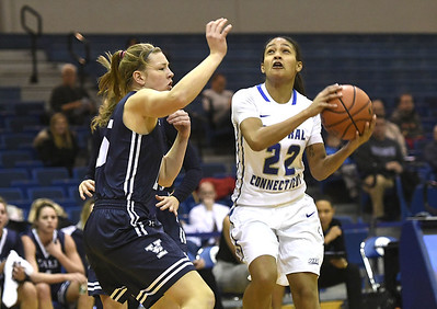 12/9/2017 Mike Orazzi   Staff CCSU's Ashley Chin (22) and Yale University's Alex Cade (15) during women's hoops in New Britain.