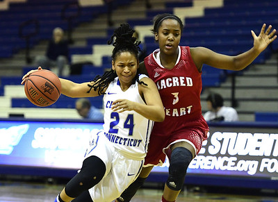 1/7/2017 Mike Orazzi | Staff CCSU's Aleah Epps (24) and Sacred Heart's Adaysha Williams (3) during Saturday's women's basketball game in New Britain.