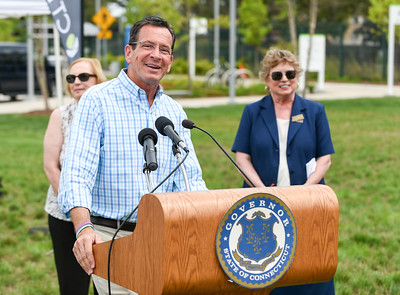 071816  Wesley Bunnell   Staff  Governor Dannel Malloy visited the downtown New Britain CT fastrak station which features a farmers market on Monday afternoons. Governor Malloy as he answers questions from members of the media.