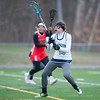 04/17/18  Wesley Bunnell | Staff<br /> <br /> Newington girls lacrosse was defeated 19-2 by Conard at Newington on Tuesday afternoon. Kiley Davies (14).