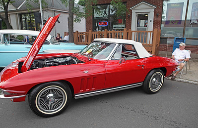 Chris Richie | Staff Jerry Olson of Newington and his 1965 Chevy Corvette at the Cruising Newington Classic Car Show on Thursday. (6/17/11)