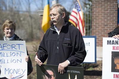 04.02.17 Christopher Burns | Special to the Herald Alex Kuzma, of Glastonbury, protested against former Trump campaign adviser Paul Manafort, a New Britain native, on Sunday, April 2.