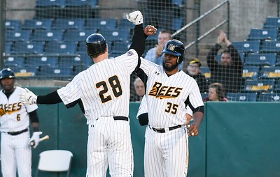 051117  Wesley Bunnell | Staff  New Britain Bees won in a 9th inning walk off home run by Conor Bierfeldt (28) on Thursday evening 4-3 over the Long Island Ducks.  Conor Bierfeldt (28) gets congratulated by Jovan Rosa (35) after driving him in with a three home run in the fourth inning.