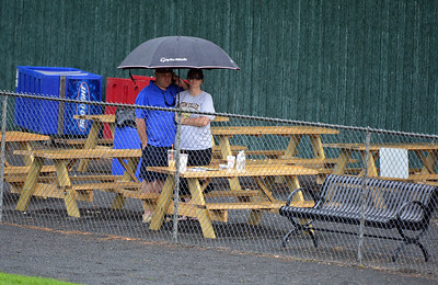 7/1/2015 Mike Orazzi   Staff A rain shower during the Bristol Blues game on Wednesday with the Martha's Vineyard Sharks at Muzzy Field in Bristol.