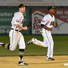 072417  Wesley Bunnell | Staff<br /> <br /> The New Britain Bees lost 2-1 to the Lancaster Barnstormers on Monday evening. Conor Bierfeldt (28), runs off the field with Jordan Hinshaw (19).