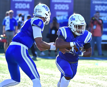 9/15/2018 Mike Orazzi | Staff CCSU's Jacob Dolegala (9) and Drew Jean-Guillaume (20) during Saturdays' football game with in New Britain.
