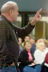 Saratoga Springs resident Phillip Diamond asked questions to Saratoga Citizen organizer Pat Kane as he spoke about a preliminary financial analysis of their proposed change to a council-manager form of government. Photo Erica Miller 1/31/11 news_SarCitizen2_Tues