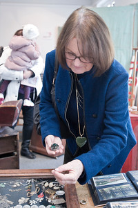 Katy Villacorta looks at a minature tea set for her doll house Sunday morning during the annual Winter Antique Show at the National Museum of Dance. Photo Eric Jenks 1/29/12