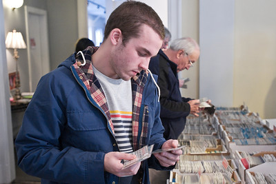 Michael Manzione looks through leap year postcards during the annual Winter Antique Show at the National Museum of Dance Sunday morning. Photo Eric Jenks 1/29/12
