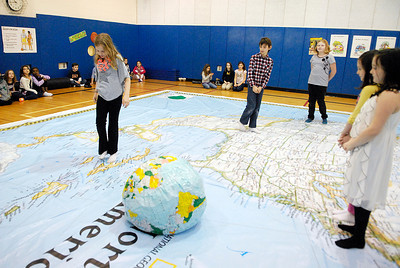 Fourth grade students in Jenn Marcantonio's class at Caroline Street Elementary make their way to different sections of North America on the National Geographic Traveling Map. The Map will be at the school till thursday where they can learn physical movement and games to teach students place names, geography and map reading skills. Photo Erica Miller 1/30/12 news_NatlGeoMap_Tues
