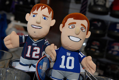 General Manager at The Stadium, located inside the Wilton Mall near Old Navy, Wayne Frankey organizes some of his Giants and Patriots nick-nacks in their store for the upcoming Superbowl this Sunday. Photo Erica Miller 1/30/12 news_Superbowl3_Tues