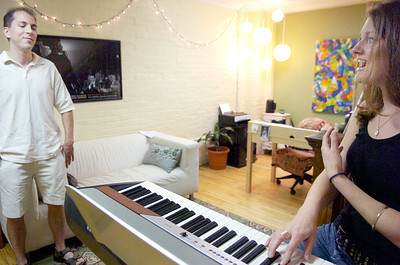 Vocal coach Sam Whitehouse practices with Brett Groff at her studio on Regents Street.Photo Erica Miller 7/30/10 news_Whitehouse1_up