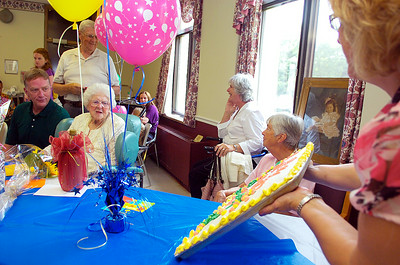 Jill Boutelle, Actives on A1 unit, holds the birthday cake as they sing happy Birthday to resident Martha Wait as she sits next to her grandson Jerry Kroll for their 108th Birthday Party at Maplewood Manor Monday afternoon. Photo Erica Miller 8/2/10 news_MarthaWait2_Tues