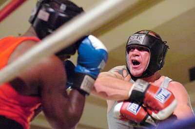 Saratoga's Josh Dulmer, right, battles with Owen Minor of Worcester, Massachusetts during a 3 round heavyweight amateur bout Friday at the Saratoga Springs City Center. Decision went to Minor. Ed Burke 7/30/10