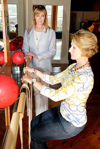 Bo Derek watches as Connie Crane, owner of Barrre Strength, demonstrates some of the pilates moves at her studio Friday evening. Photo Erica Miller 7/30/10 news_BoDerek1_Sat