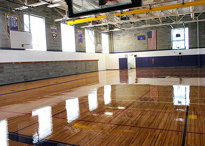 The gym floor at Saratoga Central Catholic reflects a new sheen after volunteers applied new striping, a logo and coating to get ready for the upcoming school year. The bleachers are also being sanded and varnished. Ed Burke 7/31/10