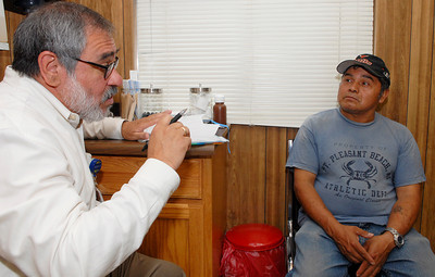 Medical Director at the B.E.S.T. Clinic Alexander Cardiel, also the Saratoga Hospital Hospitalist, talks to patient Cruz Latin during the Backstretch employee health fair held on the Recreation Center, next to the Clinic. Photo Erica Miller 8/2/11 news_HealthFair3_Wed