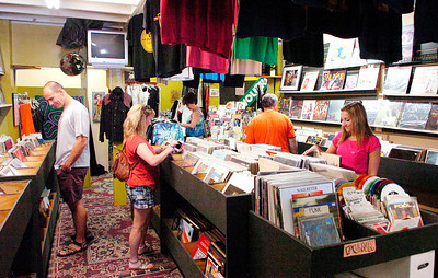 Customers browse music selections at Divinyl Revolution. Ed Burke 7/30/11