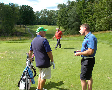 Course Pro Todd Manderson, right, talks with golfers Wednesday on the new tee on the fifteenth hole at Ballston Spa Country Club. . Ed Burke 6/30/10