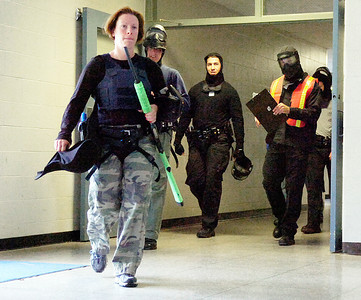 Members of Saratoga Springs Police Department officers head back into the TA at the Saratoga Springs High School Wednesday morning after training. Photo Erica Miller 6/30/10 news_sspdTraining2_Thurs
