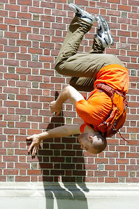 American Parkour of Washington D.C. Travis Graves leasp off the Spa Little Theatre walls for the filming of SUNY Empire State College ad by Elevation Films Tuesday. Photo Erica Miller 6/29/10  news_EmpStateAd5_Wed