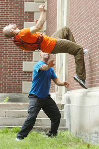 Coordinator for American Parkour of Washington D.C. helps Travis Graves practice a backflip off the Spa Little Theatre walls for the filming of SUNY Empire State College ad by Elevation Films Tuesday. Photo Erica Miller 6/29/10  news_EmpStateAd4_Wed