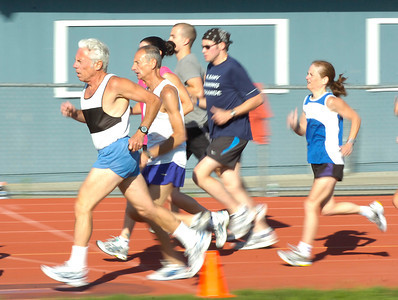 The Saratoga Stryders running club works out Wednesday at Saratoga Springs High School. Club coach Jeffrey Lutzker is second from left. Ed Burke 6/30/10