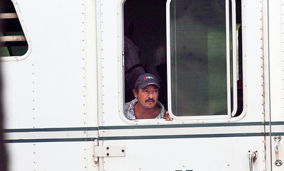 Hot walker for Rachel Alexandra Juan Gonzalez peers out the trailer as they arrive to Saratoga Race Course on the Oklahoma Track. Photo Erica Miller 6/30/10 spt_RachelSAR3_Thurs