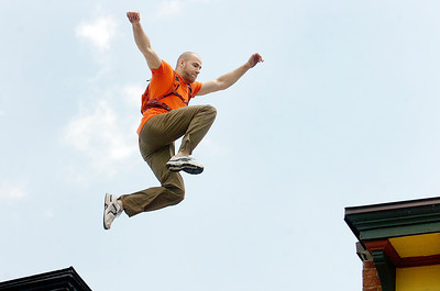American Parkour professional Travis Graves, of Washinton D.C., leaps between the roofs of Spring Street Deli and Little India on Court Street for the filming of SUNY Empire State College ad by Elevation Films Tuesday. Photo Erica Miller 6/29/10  news_EmpStateAd1_Wed