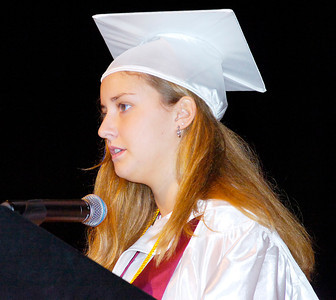 Stillwater valedictorian Kimberly Hall delivers her address during Saturday's graduation ceremony. Ed Burke 6/26/10