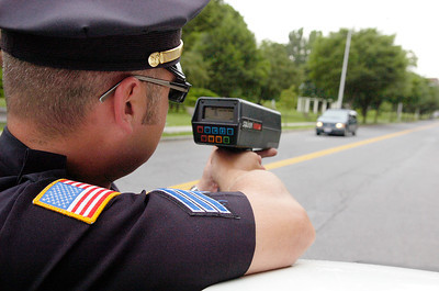 Saratoga Spring Police Department Sgt. Andrew Prestigiacomo scans speeds on High Rock Ave. Monday afternoon. Photo Erica Miller 6/28/10 news_ScanSpeed_Tues