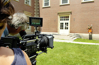 Videographer Taylor Morrison and crew film America Parkour professional Travis Graves, of Washinton D.C., as he flips off the walls of Spa Little Theatre for the filming of SUNY Empire State College ad by Elevation Films Tuesday. Photo Erica Miller 6/29/10  news_EmpStateAd2_Wed