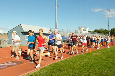 Members of the Saratoga Stryders leave in groups to start their workout Wednesday evening at Saratoga Springs High School. Ed Burke 6/30/10