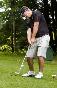 Golf Pro at McGregor Golf Course in Wilton Tom Oppedisano tees off at the 18th tee Wednesday afternoon. Photo Erica Miller 6/29/11 spt_McGregor1_Thurs
