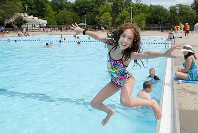 Katherine Sorros, 11 year-old, leaps into the pool at the Saratoga Spa State Park Peerless Pool on Thursday afternoon. Photo Erica Miller 6/30/11 news_Peerless2_Fri