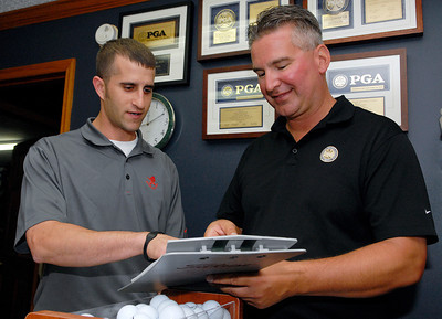 Golf Pro at McGregor Golf Course in Wilton Tom Oppedisano and Assistant Rocky Boscia review the tee sheet at the Golf Shop Wednesday afternoon. Photo Erica Miller 6/29/11 spt_McGregor2_Thurs