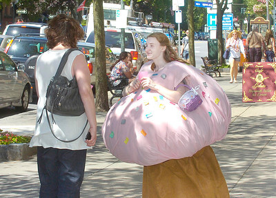Cute as a cupcake but sometimes mistaken for a mushroom, Missy LaShomb of Ballston Spa hands out coupons along Broadway for Bettie's Cakes in the Saratoga Marketplace. Ed Burke 6/30/11