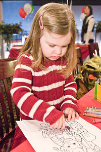 Ella Warden colors in an Elf during Longfellow's Dickens Village Festival Sunday. Attendees could look for gifts in a faux English market, visit with Santa, eat Victorian styled food and have a good time. Photo Eric Jenks 11/28/10