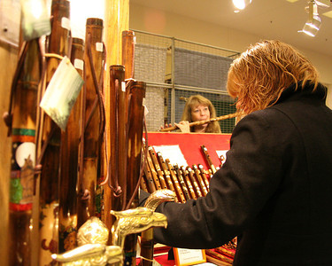 Linda Barbadoro of Stockbridge, Massachusetts, plays one of her handmade bamboo flutes Saturday at the annual craft fair to benefit Saratoga Center for the Family at the Saratoga Springs City Center.  Photo by: Alexander Spinelli 11/17/10