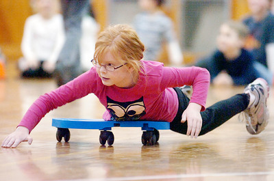 Margaret Scala rolls her way across the gym at Caroline Street Elementary for the 3 week Fitness Fun Monday evening, this is their 10th year. Photo Erica Miller 11/29/10 news_FitnessFun4_Tues
